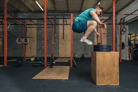 Male Crossfit Trainer Jumping